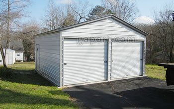 Alabama installation showing a 20x20 metal garage with 2 9x8 roll-up locking garage doors.