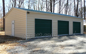 Long Metal Garage Building Sample Showing Three Roll Up Doors And One Entry Door