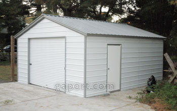 White garage with grey trim, one roll-up garage door on the end and side entry door.