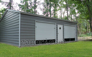 Dark Grey Metal Garage With Door Roll Up Doors And An Entry Door Centered  Between