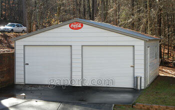 Displaying a 24 by 25 steel two car garage with neutral pewter grey colored siding.