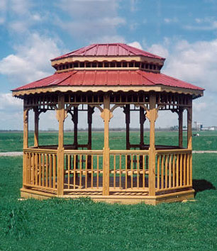 Pictured here is a gorgeous 10x12 oblong gazebo with red metal roof and benches.