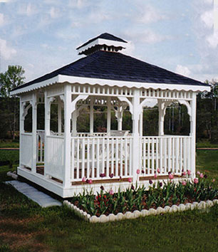 A beautifully pictured square white crafted gazebo with shingled double roof.