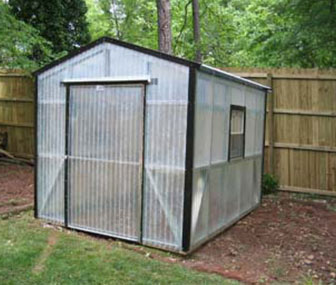 Illustrated here is an 8x10 fiberglass greenhouse with black trim, neatly matching your home.