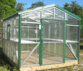 A 10x12 polycarbonate greenhouse, a beautiful addition to your backyard for growing plants year round.