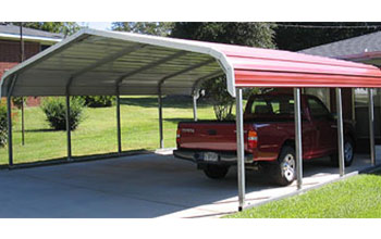 This is a common but popular red rounded roof style carport with white trim on gravel.