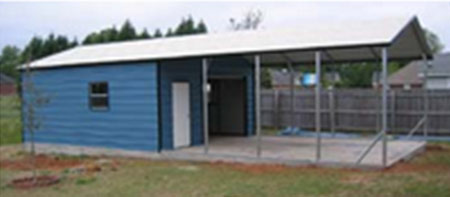 A metal utility storage garage with roll up door and attached carport cover for parking.