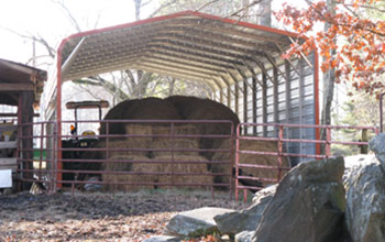 An excellent use of space, this sturdy and gorgeous metal covered area for hay and tractor.