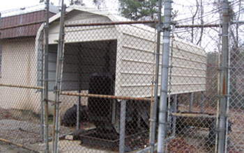 Even a very small, industrial outdoor metal covered space protects from inclement weather.