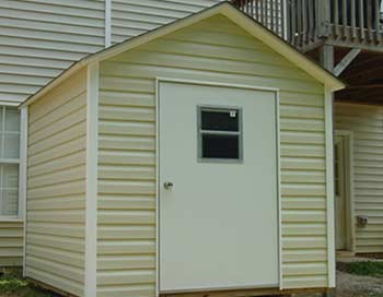a vinyl building with a large door is an excellent storage solution - Garden Sheds Vinyl