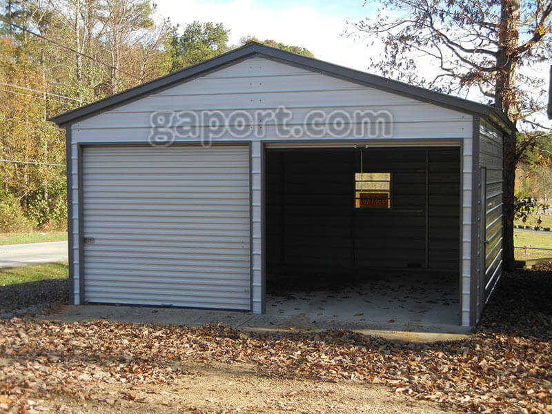 A Tidy 20 X 20 Metal Garage With Roll Up Doors.