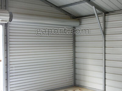 Interior Of Metal Garage Shows Roll Up Door And Support