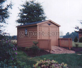 Pictured here is a lovely shingled wooden sided building with a gradually sloping wood ramp.